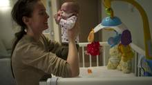 Mom Jodi Grimbleby and her daughter Arwynn are seen in the NICU at Sunnybrook Health Sciences Centre in Toronto, Ontario Monday, December 9, 2013. (Kevin Van Paassen/The Globe and Mail)