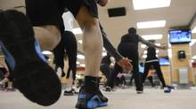 People work out at a GoodLife Fitness location in Toronto in 2013. Up to 20 per cent of people fail to see improvements in metabolic health after prolonged exercise regimens, researchers say. (Fred Lum/The Globe and Mail)