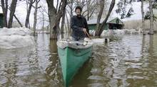 Flooding in Manitoba, Saskatchewan and Alberta between 2011 and 2014 cost more than $11-billion in economic losses. (David Lipnowski/THE CANADIAN PRESS)