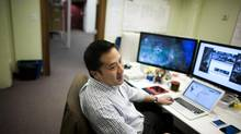 Steve Lin, General Manager at Gree Canada, which develops such mobile video games as Call to Arms, Legends at War and Beyond the Dead, works at the Gree studios in Vancouver, B.C. (Rafal Gerszak For The Globe and Mail)
