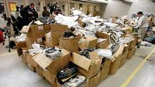 Counterfeit goods are displayed at a Toronto police press conference in 2007. Lawyers say brand owners, regulators and police have barely scratched the surface of a growing, multibillion-dollar illegal industry. (Tibor Kolley/The Globe and Mail)
