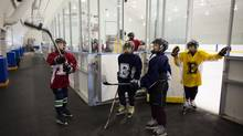Brett Duthie, left, works on his puck skills with fellow students before hitting the ice for afternoon ice time at the Edge School for Athletes in Calgary, Alberta, November 12, 2012. (Todd Korol)