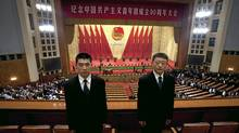 Two Chinese soldiers dressed as ushers stand guard while members of Communist Youth League leave a conference to celebrate the 90th anniversary of the founding of Chinese Communist Youth League at the Great Hall of the People in Beijing Friday, May 4, 2012. () (Alexander F. Yuan/Associated Press/Alexander F. Yuan/Associated Press)