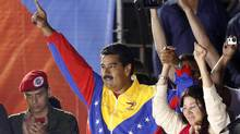 Venezuelan presidential candidate Nicolas Maduro and his wife Cilia Flores celebrate after the official results gave him a narrow victory in the balloting, in Caracas April 14, 2013. (Tomas Bravo/REUTERS)
