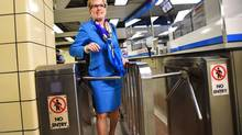 Ontario Premier Kathleen Wynne walks through TTC turnstiles before riding the subway en route to her speech at the Toronto Region Board of Trade in Toronto Monday, April 14, 2014. (Darren Calabrese/THE CANADIAN PRESS)