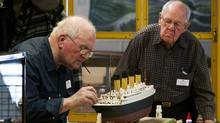 Volunteers John Green, left, and Gerald Wright construct a scale model of RMS Titanic at the the Maritime Museum of the Atlantic in Halifax on Thursday, Feb. 16, 2011. (Andrew Vaughan/THE CANADIAN PRESS/Andrew Vaughan/THE CANADIAN PRESS)