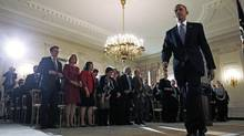 President Barack Obama leaves the State Dining Room of the White House in Washington, Thursday, Oct. 17, 2013. His signature health-care act was left untouched despite a last-ditch Republican effort to block or modify the law. (Charles Dharapak/AP)
