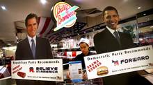 Life-sized cutouts of U.S. President Barack Obama, right, and Republican presidential candidateMitt Romney stand at the entrance of Billy Bombers diner in Singapore, Nov. 6, 2012. (Wong Maye-E/AP)