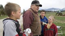 Winston Blackmore the religious leader of the polygamous community of Bountiful located near Creston, B.C. speaks with some of his children Monday, April 21, 2008 near Creston, B.C. (Jonathan Hayward/ The Canadian Press/Jonathan Hayward/ The Canadian Press)