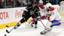 Los Angeles Kings centre Anze Kopitar plays for the puck against Montreal Canadiens defenceman P.K. Subban and defenseman Andrei Markov during the second period at Staples Center in Los Angeles on March 3, 2016. (Gary A. Vasquez/USA Today Sports)