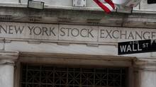 This Oct. 2, 2014, file photo, shows the Wall Street entrance of the New York Stock Exchange. (Richard Drew/AP)