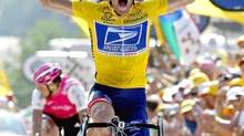 In this July 22, 2004, file photo, overall leader Lance Armstrong reacts as he crosses the finish line to win the 17th stage of the Tour de France cycling race between Bourd-d'Oisans and Le Grand Bornand, French Alps. (Laurent Rebours/AP)