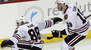 Chicago Blackhawks right wing Patrick Kane (88) celebrates with Jonathan Toews (19) after Kane scored against the Philadelphia Flyers in the third period of Game 3 of the NHL Stanley Cup hockey finals Wednesday, June 2, 2010, in Philadelphia. (AP Photo/Kathy Willens)