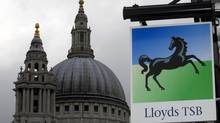 A Lloyds bank branch sign is seen near St Paul's Cathedral in the City of London. (ANDREW WINNING/REUTERS)