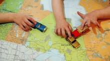 Toy cars drive over a map of Canada in this photo illustration. (Cheryl Clock/The Canadian Press)
