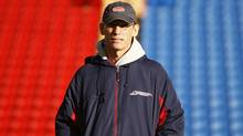 Montreal Alouettes coach Marc Trestman watches his team's CFL Grey Cup practice in Calgary, Alberta, November 25, 2009. (Reuters)