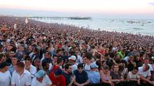 Some of the 200,000 crowd at Brighton beach, southern England in July, 2002, during Europe's biggest free beach party. A dating website says fewer than one in eight British men would be considered beautiful enough for its users. (YUI MOK/YUI MOK/AP)