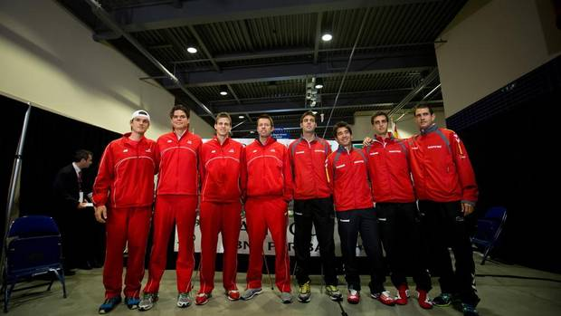 From left to right, Canada's Frank Dancevic, of Niagara Falls, Ont., Milos Raonic, of Toronto, Ont., Vasek Pospisil, of Vernon, B.C., Daniel Nestor, of Toronto, Ont., and Spain's Marcel Granollers, Marc Lopez, Albert Ramos and Guillermo Garcia-Lopez pose for photographs together after the draw for their Davis Cup tennis tie in Vancouver, B.C., on Thursday January 31, 2013. The matches are being held Feb. 1-3. (DARRYL DYCK/THE CANADIAN PRESS)