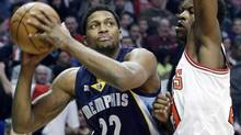 Memphis Grizzlies forward Rudy Gay, left, looks to the basket as Chicago Bulls guard Jimmy Butler guards during the first half of an NBA basketball game in Chicago on Saturday, Jan. 19, 2013. (Nam Y. Huh/AP)