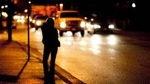 A prostitute works the streets of Vancouver's downtown Eastside in 2009. (JOHN LEHMANN/JOHN LEHMANN/GLOBE AND MAIL)