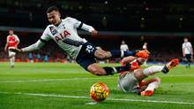 Tottenham's Dele Alli is tackled by Arsenal's Mathieu Debuchy during a Premier League match at Emirates Stadium in London, England, on Nov. 8, 2015. (Clive Rose/Getty Images)