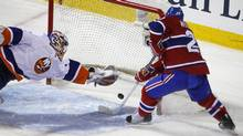 New York Islanders goalie Mikko Koskinen makes a diving save on Montreal Canadiens defenseman James Wisniewski during the second period of NHL hockey action in Montreal, February 10, 2011. (SHAUN BEST/REUTERS)