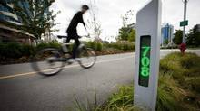 Commuters ride past a bicycle counter on a bike path near Terminal and Quebec St. in Vancouver, British Columbia on September 1, 2014. (Ben Nelms/BEN NELMS / The Globe & Mail)