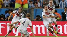 Germany's Mario Goetze, second right, celebrates with teammates after scoring the lone goal during the World Cup final soccer match between Germany and Argentina at the Maracana Stadium in Rio de Janeiro, Brazil, Sunday, July 13, 2014. (Frank Augstein/AP)