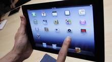 In this March 7, 2012 file photo, a new Apple iPad is on display during an Apple event in San Francisco. (Paul Sakuma/AP)
