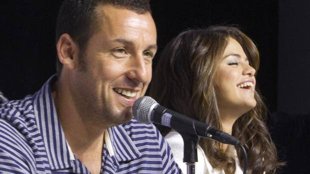 "Actors Adam Sandler (L) and Selena Gomez attend a news conference to promote the film ""Hotel Transylvania"" during the 37th Toronto International Film Festival September 8, 2012. (FRED THORNHILL/REUTERS)"