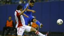 Montreal Impact Lamar Neagle (back) fights for the ball with Toronto FC Miguel Aceval during the first half of their first leg of the 2012 Amway Canadian Championships soccer match in Montreal, Quebec May 2, 2012. (OLIVIER JEAN/REUTERS)