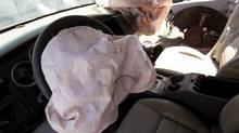Deployed Takata manufactured airbags are seen on the driver and passenger side of a 2007 Dodge Charger at a recycled auto parts lot in Detroit, Michigan May 20, 2015. (Rebecca Cook/REUTERS)