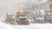 Snowplows clear the street in Oakville after an overnight snowfall on Feb. 5, 2014. The snowfall is expected to continue until the late afternoon.(Peter Power/The Globe and Mail) (Peter Power/Peter Power)