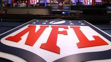 A large NFL logo decorates the stage before the first round of the NFL football draft at Radio City Music Hall, Thursday, April 25, 2013, in New York. (JASON DECROW/AP)