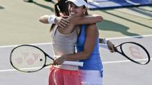 Martina Hingis, right, hugs Flavia Pennetta after the two defeated Cara Black and Sania Mirza in a semi-final doubles match of the 2014 U.S. Open tennis tournament, Thursday, Sept. 4, 2014, in New York. (Charles Krupa/AP)