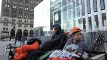 People line up in front of the Apple Inc. store on Fifth Avenue in advance of the sale of the iPhone 5 in New York on Monday, Sept. 17, 2012. (Peter Foley/Bloomberg)