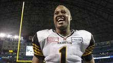 Hamilton Tiger-Cats quarterback Henry Burris celebrates after beating Toronto Argonauts 36-24 to win the CFL eastern conference final in Toronto on Sunday November 17 , 2013. (Chris Young/THE CANADIAN PRESS)