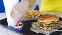 New research shows women who have been under psychological pressure burn fewer calories and less fat after a high-fat meal. (Matthew Ennis/Getty Images/iStockphoto)