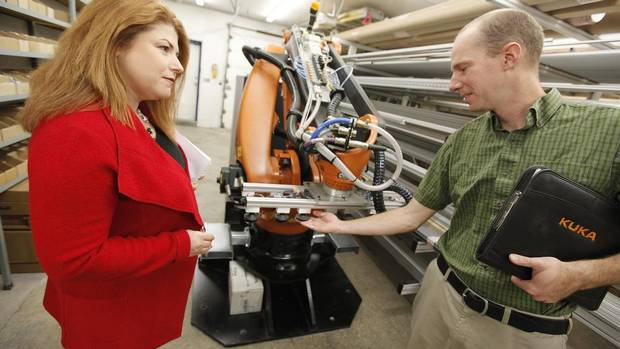Jenifer Bartman, principal of Jenifer Bartman Business Advisory Services works with Phil Bernardin, CEO of Eascan Automation, in his manufacturing facility in Winnipeg Thursday October 11, 2012 (JOHN WOODS/GLOBE AND MAIL)