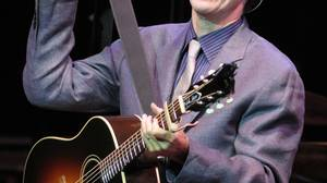 John Hiatt changes guitars between songs while performing at Massey Hall in Toronto, June 29, 2010.