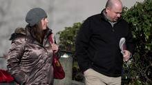 Robert MacKay, right, and an unidentified woman arrive at Provincial Court in Vancouver, B.C., on Tuesday February 4, 2014. The trial of four men accused of assaulting MacKay during the Stanley Cup riot in Vancouver has heard that as soon as cars were set ablaze and store windows were smashed, there was little police could do to stop people from swarming into the downtown core. (DARRYL DYCK/THE CANADIAN PRESS)