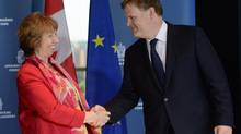 EU foreign policy chief Catherine Ashton shakes hands with Foreign Minister John Baird in Ottawa on Monday September 8, 2014. (Sean Kilpatrick/THE CANADIAN PRESS)
