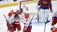Washington Capitals defenceman John Erskine (4) celebrates with teammates Martin Erat (10) and Troy Brouwer (20) after scoring a goal against Montreal Canadiens goalie Carey Price (31) during the second period at the Bell Centre. (Eric Bolte/USA Today Sports)
