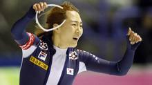 Korea's Sang-Hwa Lee celebrates her new World Record during the ladies 500-metre competition at the ISU World Cup speed skating event in Calgary on Sunday. (Jeff McIntosh/THE CANADIAN PRESS)