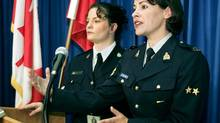 RCMP Cpl. Catherine Galliford (right) answers media questions as Vancouver Police Sgt. Sheila Sullivan looks on at left during a news conference on the Missing Women Joint Task Force in Vancouver Wednesday, Oct. 6, 2004. (CHUCK STOODY/CP)
