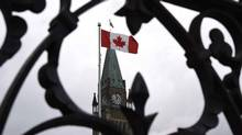 The Peace Tower, shown through the gates of Parliament Hill. (Justin Tang/THE CANADIAN PRESS)