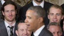 Chicago Blackhawks defenseman Duncan Keith, left, and winger Patrick Kane, right, watch President Barack Obama during a ceremony to honor the 2015 NHL Stanley Cup Champion Chicago Blackhawks. (Pablo Martinez Monsivais/AP)