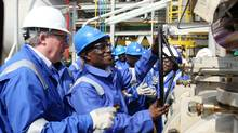 Ghanaian President John Atta Mills (2nd R) turns the valve to flag off first oil production at FPSO Kwame Nkrumah oil rig at the Jubilee field in Takoradi on Dec.15, 2010. (Pius Utomi Ekpei/AFP/Getty Images/Pius Utomi Ekpei/AFP/Getty Images)