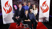 Inductees to the Canada's Sports Hall of Fame, left to right, Dick Pound, a former vice-president of the International Olympic Committee, former B.C. Lions kicker Lui Passaglia, Andrea Neil, a former assistant coach with the Canadian women's soccer team and two-time W-League soccer champion, Ray Bourque, a Stanley Cup winner and member of the Hockey Hall of Fame, Peter Reid, a former Ironman champion and Lauren Woolstencroft, winner of 10 Paralympic ski medals sit for a group photo at the hall in Calgary, Alta., Tuesday, Nov. 8, 2011. (Jeff McIntosh/THE CANADIAN PRESS)