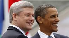 Canada's Prime Minister Stephen Harper (L) greets United States President Barack Obama at the G8 Summit at the Deerhurst Resort in Huntsville, Ontario, June 25, 2010. (Chris Wattie/Reuters/Chris Wattie/Reuters)